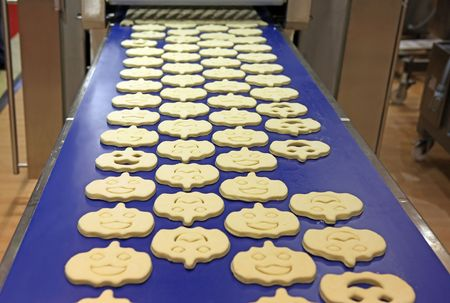 cake factory: Cookies industrial production at factory from fancy pastry Stock Photo