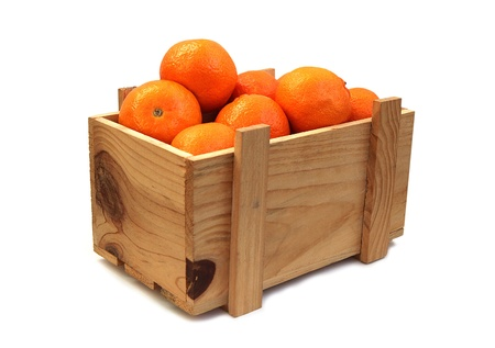 Bright Tangerines in a wooden box in white background Stock Photo - 8582097
