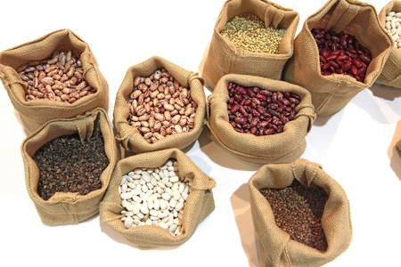 Different grades of a string bean and buckwheat in sacks for demonstration to buyers photo