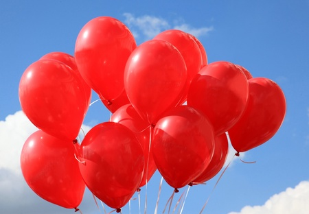 sky is the limit: Red balloons against the blue sky