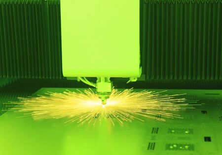 Industrial laser cutter with green background, with sparks Stock Photo - 9964878