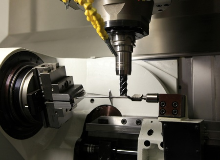 Manufacturing of a difficult detail on the milling machine tool Stock Photo - 9964883