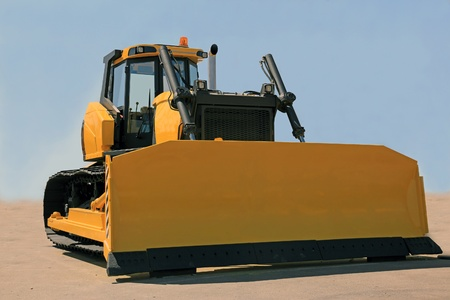 A large yellow bulldozer at a construction site photo
