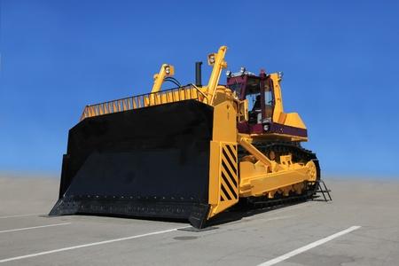 bulldozers: A large yellow bulldozer at a construction site