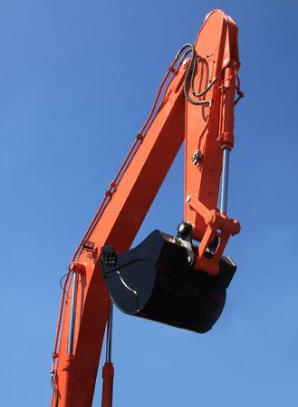 excavator bucket against the blue sky photo