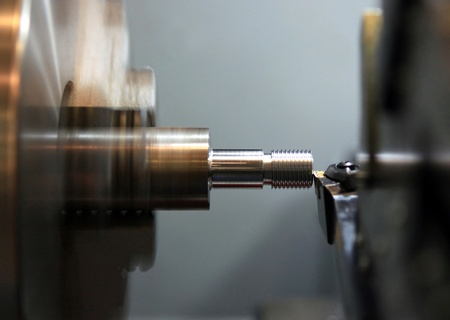 Facing operation of a metal blank on turning machine with cutting tool photo
