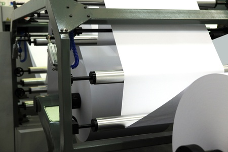print media:  offset print machine for newspaper production from big rolls of paper.