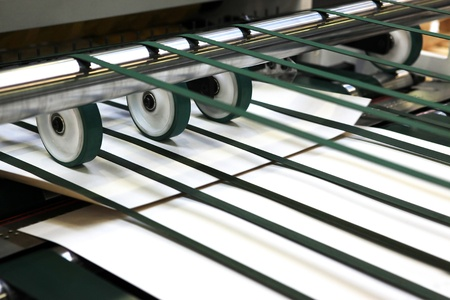 Part of the machine of offset printing - paper giving in the mechanism Stock Photo