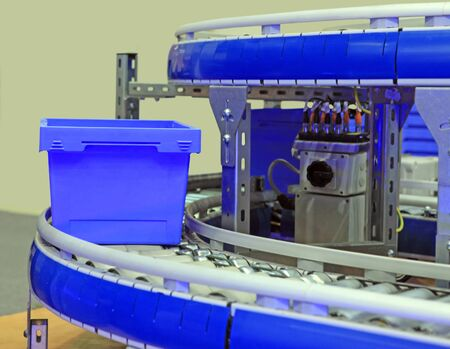 moves: blue box moves on a roller on the conveyor