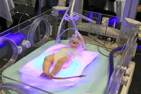 Newborn baby incubator with a dummy of the child