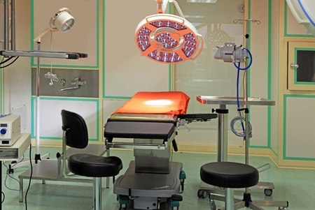 operating table: Equipment for the operating room A special operational table, lamps, devices Editorial