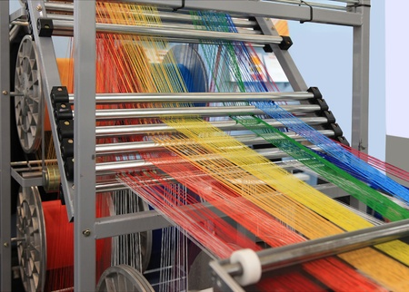 textile industry: yarn warping machine in a textile weaving factory  Stock Photo