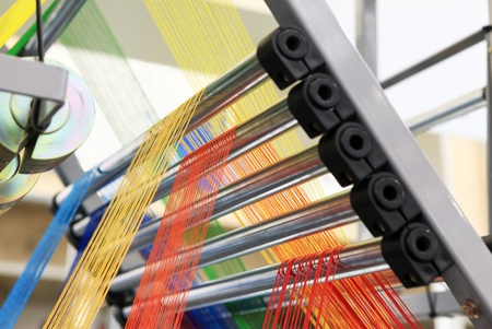 the textile industry: yarn warping machine in a textile weaving factory  Stock Photo