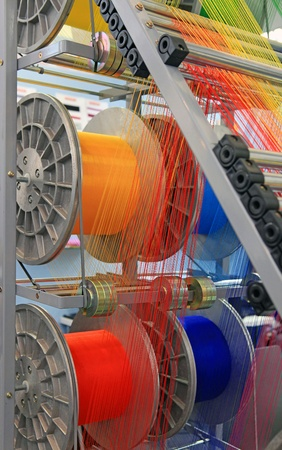 yarn warping machine in a textile weaving factory  photo