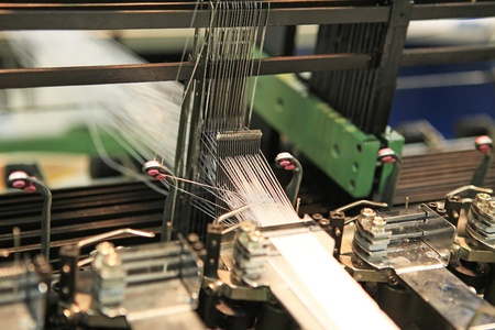 cloth manufacturing: Close-up mechanisms of textile machinery in the factory Stock Photo