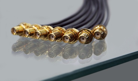 connectors of a coaxial cable of high frequency with gilding on lie glass photo