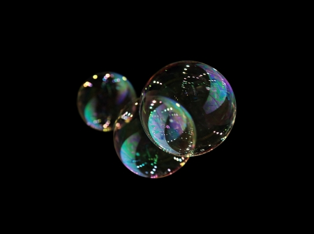refraction of light:  Soap bubbles isolated on black. Extremely detailed.  Stock Photo