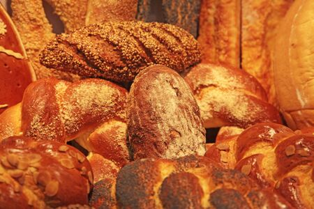 assortment of baked bread of different grades closeup photo