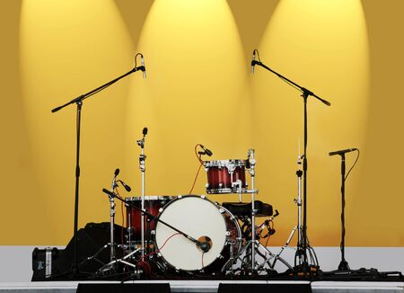 drum set: drums are established on a scene before performance of jazz group of actors
