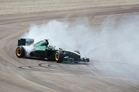racecar: Formula One Car carries out a turn on the racing route