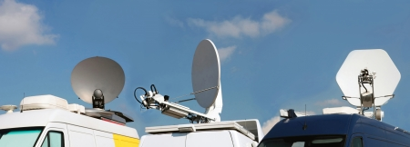 media equipment: Mobile satellite dishes on roofs of cars for a television signal