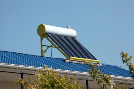Water heating solar panels on the roof  photo