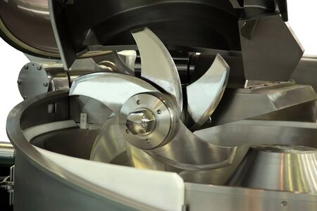 food processing: Industrial meat grinder close up - mincing-machine