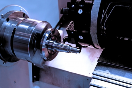 metal blank machining process on lathe with cutting tool  photo