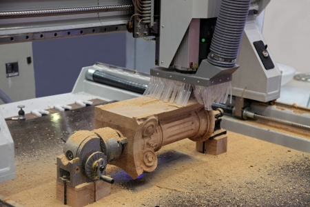 wood turning: The machine for milling of difficult details from wood Stock Photo