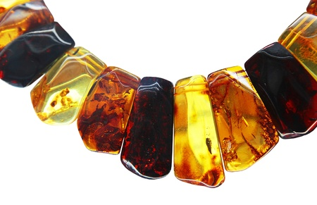 amber: necklace from amber of different shades of on white background