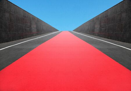 red wall: the red carpet among granite walls conducts to the dark blue sky Stock Photo