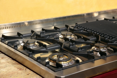 color range: Stove stainless steal top macro close up.