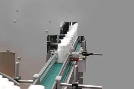 The Automatic Transfer Line on Gluing of Labels on Packings with Medicines