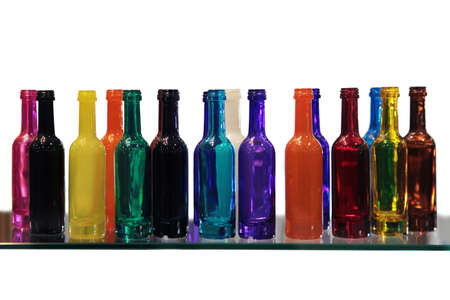 Collection of Glass Bottles of Different Coloring photo