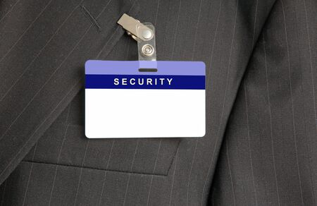 nametag: Close Up of Black Suit with Security ID Card