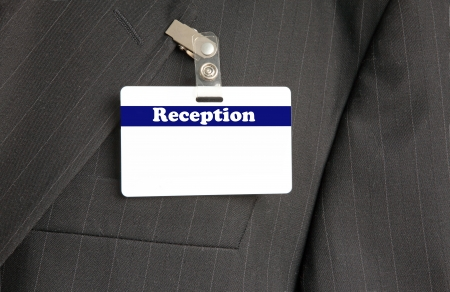 id card: Close Up of Black Suit with Reception ID Card Stock Photo