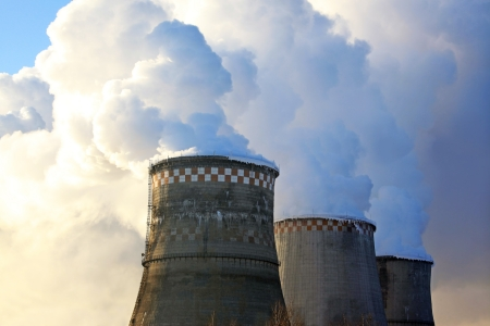 convection: Cooling Towers of a Power Plant with Steam  and Sky  Stock Photo