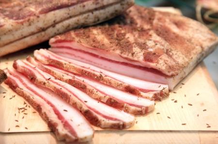 streaky: Cut the Bacon on a Wooden Board