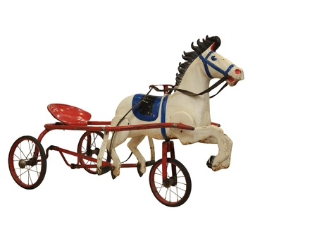 antique tricycle: A Childs Red Tricycle made in the form of horses   Stock Photo