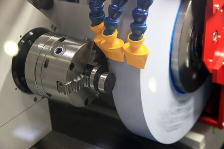 Grinding of a round detail on the special machine tool photo