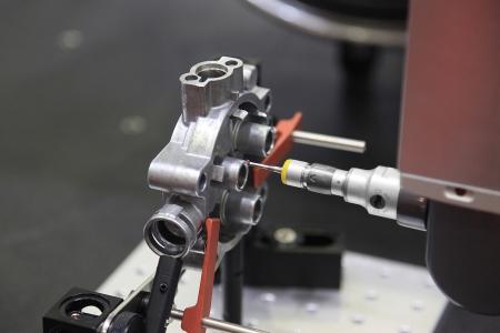 Close-up check measurement of detail by precision detecting head sensor  Фото со стока