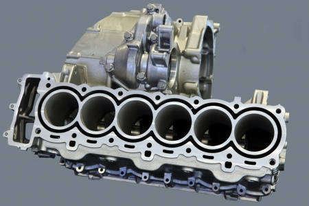 benzin: Part of car engine with the transmission in a rugged aluminum enclosure Stock Photo