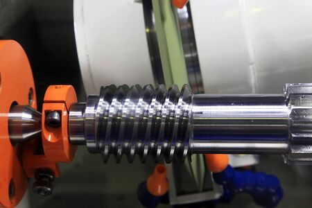 worm gear: Grinding steel worm-gear on the special machine Stock Photo