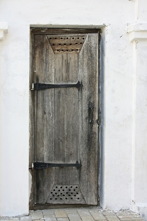transom: Old wooden door in a white wall