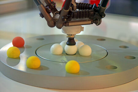 moves: Industrial robot moves the balls vacuum tool