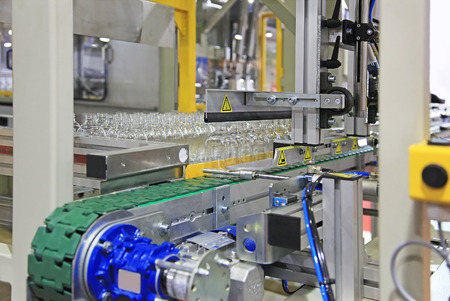 Automatic line for packing of plastic bottles after production Stock Photo