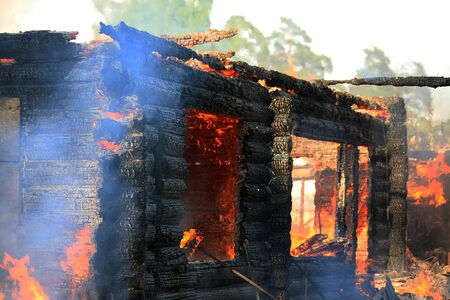 home protection: In the village burning of a large wooden house