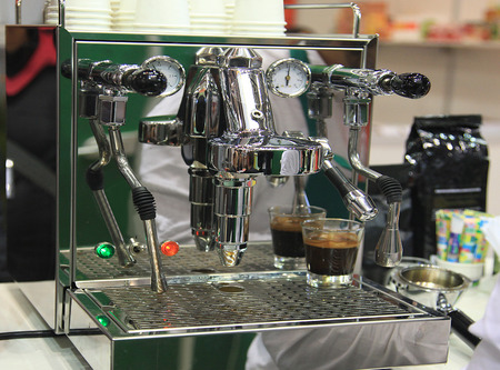 proffessional: Proffesional espresso machine and coffee grinder in the kitchen Editorial