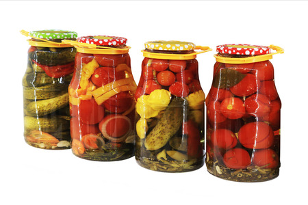 collection set of canned vegetables in glass jars isolated on white background photo