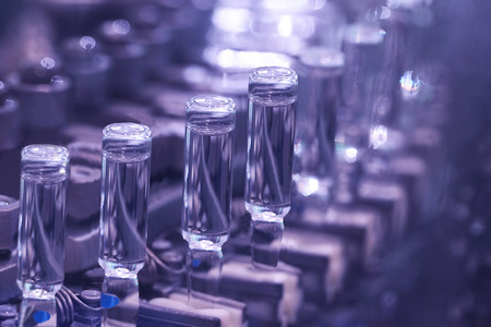 production of medicines in ampoules on automatic lines 스톡 콘텐츠